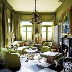 Designer Peter Rogers' own antebellum living room painted chartreuse green walls, trim and moldings