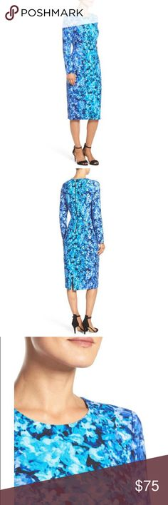 """Nagy London Floral Crepe Sheath Dress Artful flowers vibrantly bloom across this crisp crepe dress that works for the office and beyond with demure long sleeves and a chic midi hem. - 43 1/2"""" length  - Back zip closure - Jewel neck - Long sleeves - Lined - 96% polyester, 4% spandex - Dry clean Maggy London Dresses Midi"""
