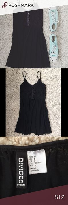 Divided black spaghetti strap dress Lace top pattern with hooks all down the top. Some strings in the straps are coming lose doesn't affect the dress. Divided Dresses Mini