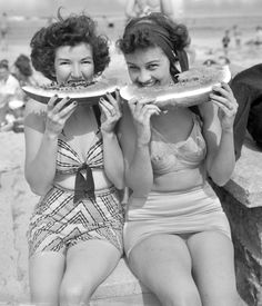 Noshing on watermelon at the beach (in wonderful vintage swimsuits) - summer doesn't get much sweeter than that! #vitage #1940s #summer #beach #women