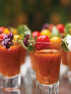 Bloody Mary Shooters.                                                                                                                1 cup chilled tomato juice  cup chilled vodka 1 Tbsp. Worcestershire sauce 2-3 drops red Tabasco pepper sauce Salt Freshly ground black pepper Garnish: cherry tomatoes and edible flowers