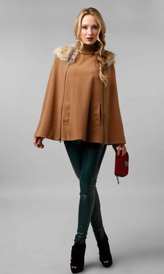 Faux fur trimmed cape and sleek faux leather leggings. #fashion #outfit #inspiration