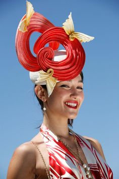 Millinery - a gorgeous red and cream quirky race day hat. Fabulous!