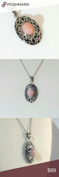 """5.2 Carat Pink Opal Pendant Necklace A beautiful 10x12mm, oval cabochon Peruvian pink opal is set in an exquisitely detailed sterling silver  pendant. This artisan crafted pendant is 1-1/2"""" long including loop and 3/4"""" wide. A 20"""" stainless steel chain is included. New.  Measurements and weights are approximate. Photos may be enlarged to show detail. Jewelry Necklaces"""