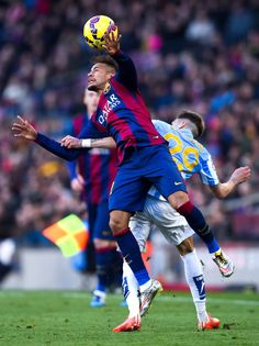 Neymar of FC Barcelona is brought down by Samu Castillejo of Malaga CF during the La Liga match between FC Barcelona and Malaga CF at Camp Nou on February 21, 2015 in Barcelona, Catalonia.