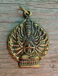 Hey, I found this really awesome Etsy listing at https://www.etsy.com/listing/195577753/brass-many-armed-buddha-pendant-from