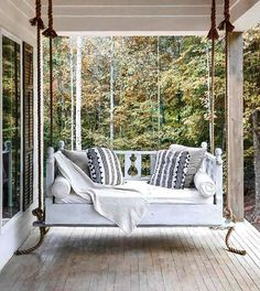 The best front porch swing styled beautifully with gorgeous textiles. Yes please! @homemadefurniture