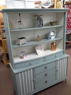 $300 - This shabby chic mid century hutch has 2 cabinets and 3 drawers on bottom, open shelves and 2 drawers on top. It has been painted in a two-tone finish, distressed and new hardware applied. One piece construction. ***** In Booth F4 at Main Street Antique Mall 7260 E Main St (east of Power RD on MAIN STREET) Mesa Az 85207 **** Open 7 days a week 10:00AM-5:30PM **** Call for more information 480 924 1122 **** We Accept cash, debit, VISA, Mastercard, Discover or American Express