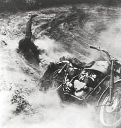 A rider falls off his motorcycle during the international championship motocross track in Denmark, 1955. Photo by Mogens von Haven.