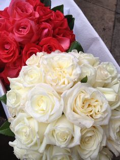 stunning traditional white and red rose bouquets for herself and her bridesmaids