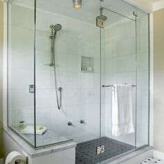 Clean and crisp shower with marble seat