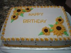 Sunflowers 13 x 9 White cake with buttercream icing and buttercream sunflowers in golden yellow.