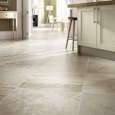 Details: Photo features Chantilly 24 x 24 field tile in a grid pattern on the floor.