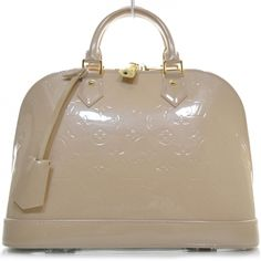 This is an authentic LOUIS VUITTON Vernis Alma PM in Rose Florentin.   The polished style and elegant detailing of this Louis Vuitton tote lend a look of stylish beauty for everyday.