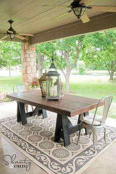 I love this back patio. From the farm table to the rock posts. DIY-ify: 10 Outdoor Organization DIY's
