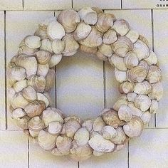 Beautiful summer wreath. I think I would prefer oyster shells...