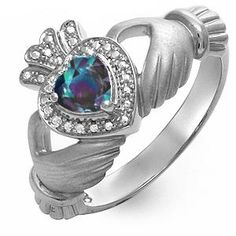 Lab created Alexandrite claddagh ring  Someday I want an engagement ring like this. <3