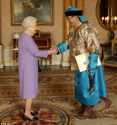 With Mongolian Ambassador, he presented his Letters of Credence in traditional dress...