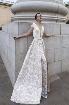 Sleek plunging neckline lace embroidered wedding dress with thigh-high slit; Featured Dress: TM Crystal Design