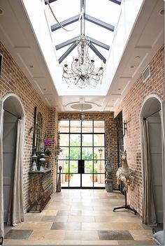 Aiden Gray home in Houston. Entryway. Smashing with that skylight and iron-clad and mullioned double doors.