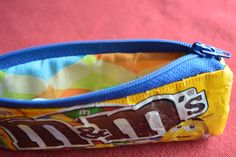 DIY Candy Wrapper Zippered Pouch: fabric, iron-on vinyl, zipper, and empty wrappers from your favorite candy!
