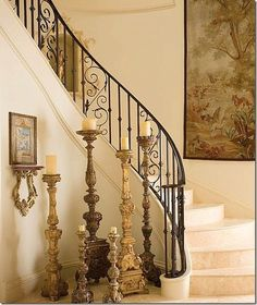 love the candle sticks and wrought iron railing