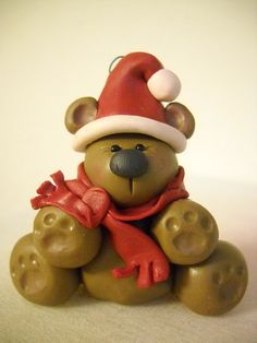 Hmm... this bear as a Panda, with pink Santa hat... would go perfectly on my little Pinkalicious's tree.