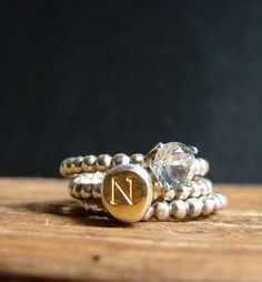 A birthstone ring, a monogram ring, and a beaded band (for balance) make up the ultimate personalized present. #etsyjewelry