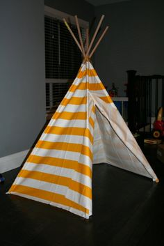 Fun DIY teepee. It was only 15 dollars to make. Love  the yellow stripe.
