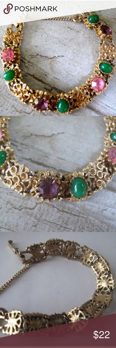 Florenza Vintage Bracelet This adorable bracelet has 12 sections that are connected with small loops. There are jade green cabs on four sections, large pink rhinestones on two, large purple rhinestones on two, and four sections that are plain. The colors remind me of Mardi Gras!    The bracelet reminds me of Florenza jewelry, but is not marked. It is seven inches in length, has a fold over closure, and a safety . Vintage Jewelry Bracelets