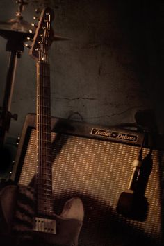 Cool Looking Picture of An Electric Guitar and a Fender Amp