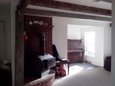 Large den with exposed barn beams