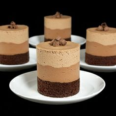 A photo of 4 Chocolate Mousse Cakes layered with Dark Chocolate Cake, Bittersweet Chocolate Mousse and Milk Chocolate Mousse displayed on small white dessert dishes with dessert forks with a black background. Triple Chocolate Mousse Cake, Chocolate Mousse Recipe, Dark Chocolate Cakes, Chocolate Desserts, Chocolate Moose, Chocolate Pavlova, Craving Chocolate, Decadent Chocolate, Mini Desserts