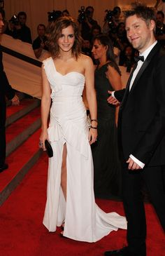 """Emma Watson Photos Photos - Actress Emma Watson and designer Christopher Bailey attends the Costume Institute Gala Benefit to celebrate the opening of the """"American Woman: Fashioning a National Identity"""" exhibition at The Metropolitan Museum of Art on May 3, 2010 in New York City. - """"American Woman: Fashioning A National Identity"""" Met Gala - Arrivals"""
