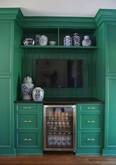 Our Green and White Kitchen Renovation, cabinets, blue and white, drink fridge, brass pulls, paint color: Deep Jungle by @benjaminmoore
