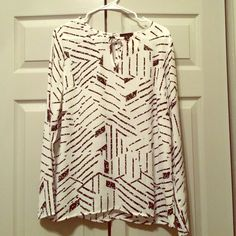 Brand NWT black and white flowy printed top Adorable brand new with tags flowy (silky feeling) white and black printed top! Super cute and great for work and play! Lumiere Tops Blouses