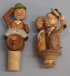 Figural carved wood bottle stoppers