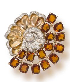 A retro citrine and diamond brooch, circa 1940  of floral design, centering an openwork pavé-set diamond stamen, one side with a double arch of cushion-shaped orange citrines, the other with gold petals detailed with single-cut diamond borders