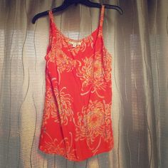 Chiffon CAbi tank top Flowy chiffon CAbi fashionable tank top. Style number 777. 100% rayon.  Has a built in bra shelf! Orange with blue and yellow flowers throughout. Straps are adjustable. Great material for the summer! No flaws. ❌NO TRADES❌ CAbi Tops Tank Tops