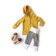 Outfit of the week: Mustard henley pullover with our striped skinny sweats + cozy slippers. Who's ready to snuggle up for a movie? #CHCoutfitoftheweek #mychildhoods #childhoodsclothing