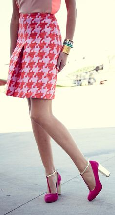 Neon and neutral color-blocked top, bright houndstooth skirt, fuchsia/gold t-strap pumps and stacked wrist
