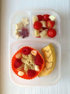 Rotini pasta with Parmesan cheese/raspberries/twisty string cheese in bits, half a banana, cherry tomatoes/cucumbers, Trader Joe's yogurt stars. #foodforharper #bento #easylunchboxes www.facebook.com/FoodForHarper