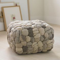 Clusters of natural felted wool are artfully woven with striations transforming into a faux riverstone pouf. Our pouf is phenomenally comfortable, firm yet … Pouf Chair, Pouf Ottoman, Ottoman Decor, Upholstered Ottoman, Wet Felting, Wool Felt, Felted Wool, Pillows, Sewing Rooms