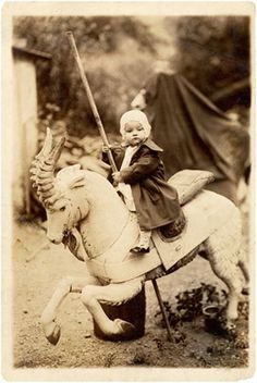 c. 1920s:  Girl on a merry-go-round horse