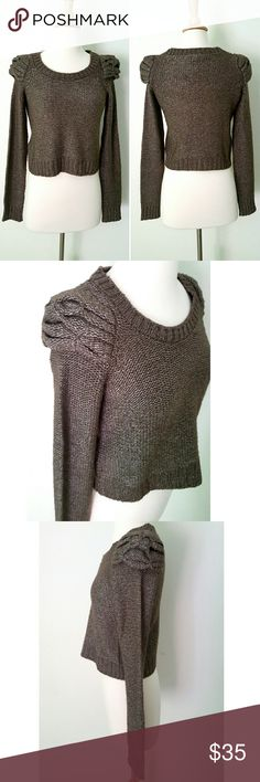 "BCBGeneration Crop Sweater Gorgeous knit sweater with high shoulder detail. Knit,  heathered brown color. 48% nylon 26% wool,  26% acrylic. 13.5"" shoulder to shoulder, 17"" armpit to armpit,  sleeves are 25"" long,  total length 17"" shoulder to bottom hem. Worn once,  in excellent LIKE NEW condition. Comes with extra thread. BCBGeneration Sweaters"