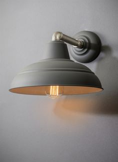 Add a touch of industrial glamour to any room with our Southwark Wall Light in Charcoal