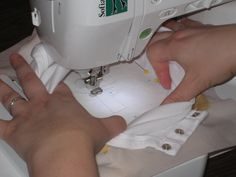 good tutorial - Onesies with the Embroidery Machine. I do it this way, too, except I don't use the spray and put a backing on the back to protect the baby's skin. Folks tell me it's not necessary, but I always have - Gymboree does!