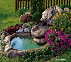 outdoor fountain with flowers and rocks