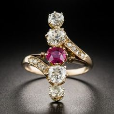 Just a smidgen shy of 1 inch long, striking and exceedingly lovely, this unique late-nineteenth century dinner ring centers on a bright vibrant red, half-carat Burmese ruby accompanied north and south by pairs of sparkling white old mine-cut diamonds, together weighing 1.50 carats. Small rose-cut diamonds glint from the bypass style shoulders. Hand fabricated-in 18K rose gold, currently ring size 6 3/4.