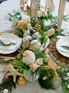 Coastal Christmas Centerpiece - Love the beach? So do I. And, that is why I wanted to include this lovely centerpiece that is both holiday-inspired but with a beach-twist. Link for image source is noted in article.